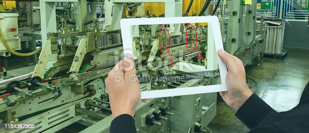911693780 istock photo iot industry 4.0 concept, Smart factory industrial engineer using tablet with augmented mixed with virtual reality technology to monitoring machine in real time to monitor, anlytic, repair machine 1154387305