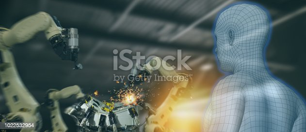 istock iot industry 4.0 concept,industrial engineer using artificial intelligence ai (augmented, virtual reality) to monitoring machine in real time.Smart factory use Automation robot arm in manufacturing 1022532954