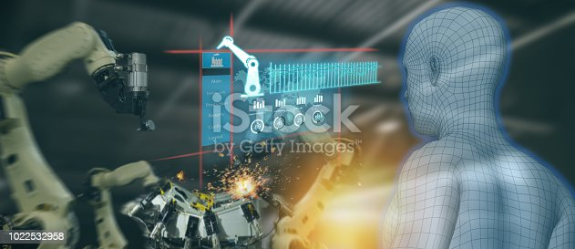 istock iot industry 4.0 concept,industrial engineer using artificial intelligence ai (augmented, virtual reality) to monitoring machine in real time.Smart factory use Automation robot arm in manufacturing 1022532958