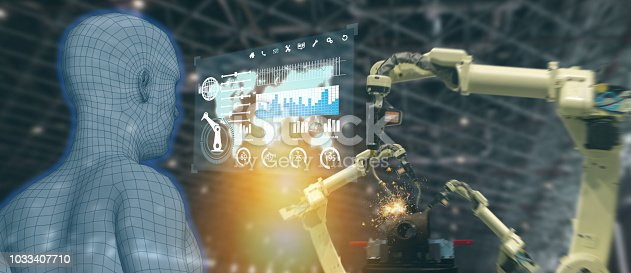 istock iot industry 4.0 concept,industrial engineer using artificial intelligence ai (augmented, virtual reality) to monitoring machine in real time.Smart factory use Automation robot arm in manufacturing 1033407710