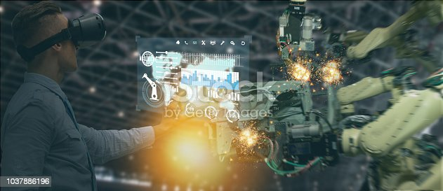 1150202730 istock photo iot industry 4.0 concept,industrial engineer(blurred) using smart glasses with augmented mixed with virtual reality technology to monitoring machine in real time.Smart factory use Automation robot arm 1037886196