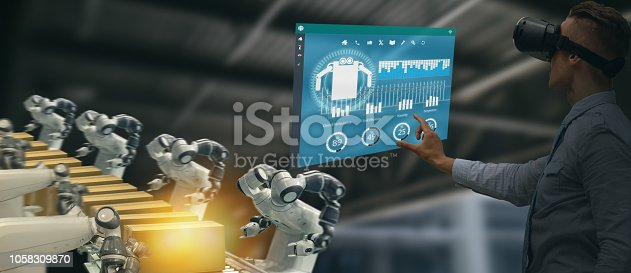 1150202730 istock photo iot industry 4.0 concept,industrial engineer using smart glasses with augmented mixed with virtual reality technology to monitoring machine in real time.Smart factory use Automation robot arm 1058309870