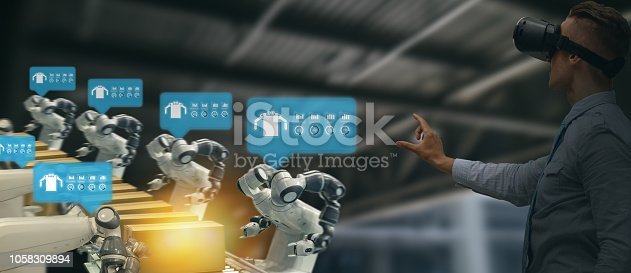 1150202730 istock photo iot industry 4.0 concept,industrial engineer using smart glasses with augmented mixed with virtual reality technology to monitoring machine in real time.Smart factory use Automation robot arm 1058309894