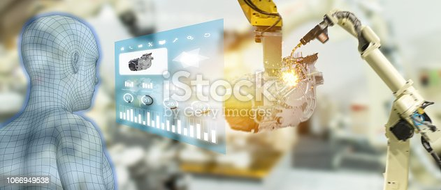 1150202730 istock photo iot industry 4.0 concept,industrial engineer using smart glasses with augmented mixed with virtual reality technology to monitoring machine in real time.Smart factory use Automation robot arm 1066949538