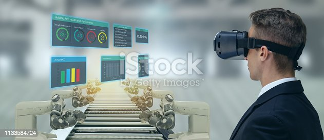 911693780 istock photo iot industry 4.0 concept,industrial engineer(blurred) using smart glasses with augmented mixed with virtual reality technology to monitoring machine in real time.Smart factory use Automation robot arm 1133584724