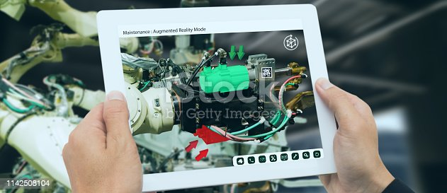 istock iot industry 4.0 concept,industrial engineer using software (augmented, virtual reality) in tablet to monitoring machine in real time.Smart factory use Automation robot arm in automotive manufacturing 1142508104