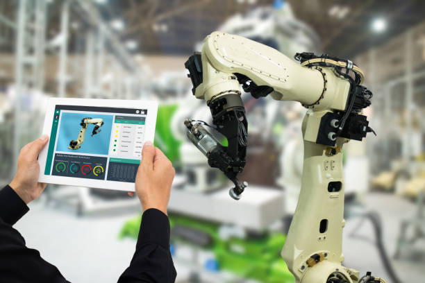 iot industry 4.0 concept,industrial engineer using software (augmented, virtual reality) in tablet to monitoring machine in real time.Smart factory use Automation robot arm in automotive manufacturing – zdjęcie