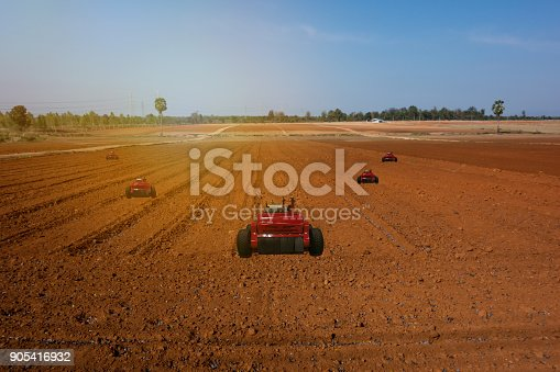 1022530858istockphoto iot, internet of things, agriculture concepts, Farmer use automatic robot assistant to work in the farm , to detect the weed ,spray the chemical use robot for replace worker and increase efficiency 905416932