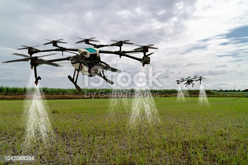 898449496 istock photo iot smart agriculture industry 4.0 concept, drone (in precision farm) use for spray a water, fertilizer or chemical to the field, farm for growth a yields,crops, use for control, kill the bug or weed 1042088354