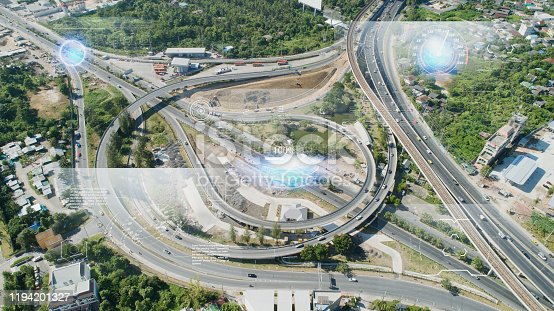 904420364istockphoto IoT(Internet of Things) smart highway futuristic technology and Transportation system concept. aerial view urban road. Communication network. Autonomous car technology of future. 1194201327