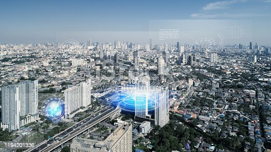 904420364istockphoto IoT(Internet of Things) smart highway futuristic technology and Transportation system concept. aerial view urban road. Communication network. Autonomous car technology of future. 1194201336