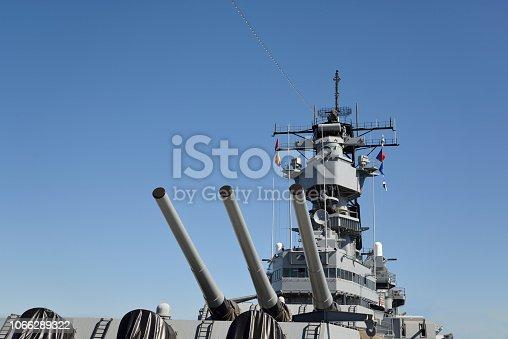 Artillery gun barrels on the USS Iowa against a simple blue sky.  Photo by Bob Balestri dba Joesboy