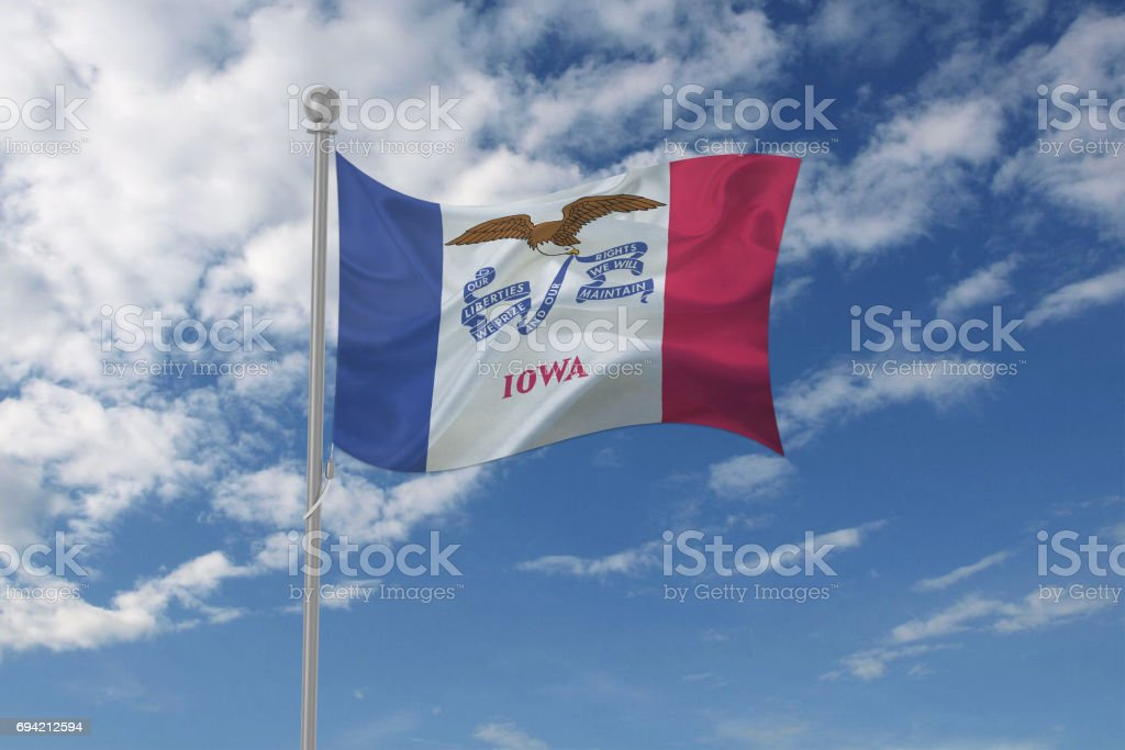 Iowa flag waving in the sky stock photo