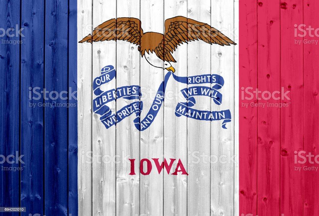 Iowa flag with wood texture stock photo