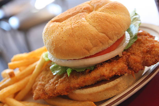Iowa Pork Tenderloin Sandwich Enjoy a taste of Iowa with a crisp, juicy, mouthwatering breaded Pork Tenderloin Sandwiches.  pork stock pictures, royalty-free photos & images