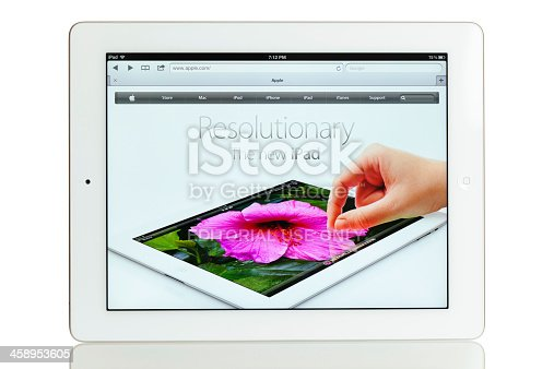 Ljubljana, Slovenia - March 23, 2012: iPad 3 - white version. Studio photo of the Apple iPad 3 on white background with the reflection on the bottom. The screen shows the Apple's homepage with the iPad 3 ad. iPad is a very popular touchscreen tablet that can be used for various purposes, from browsing the internet, playing games, watching movies to eBook reading.