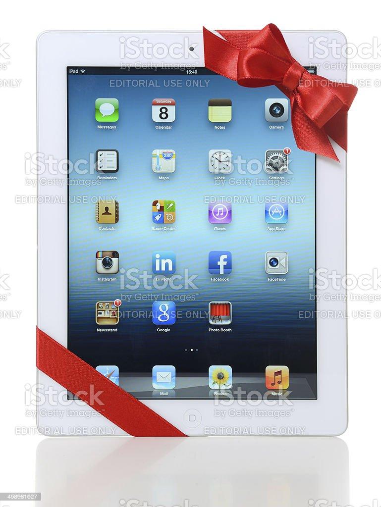iPad 3 with red ribbon stock photo