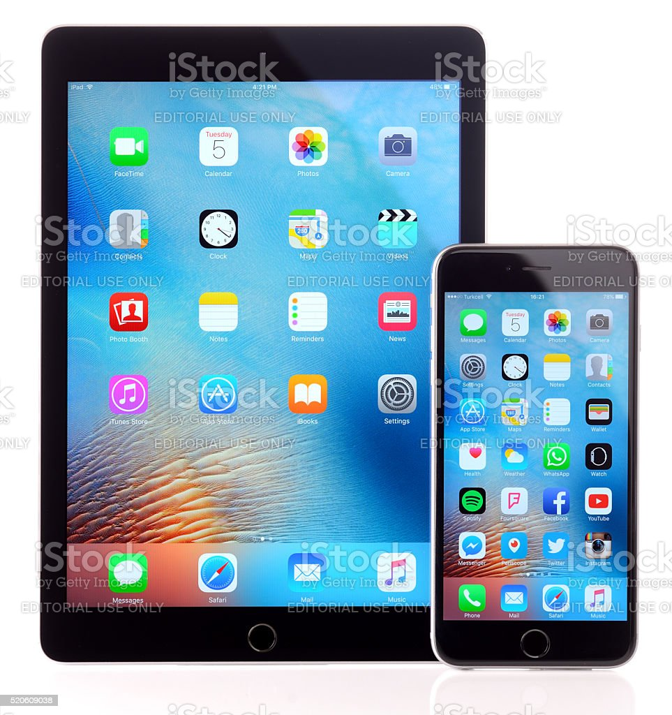 iPad Air 2 and iPhone 6 Plus on white background stock photo