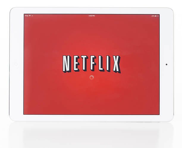 Ipad Air and Netflix Las Vegas, USA - January 06, 2014: A photo of a white Apple iPad Air isolated on a white background showing the Netflix app running. The iPad Air is the fifth generation iPad tablet computer designed and developed by Apple Inc. netflix stock pictures, royalty-free photos & images