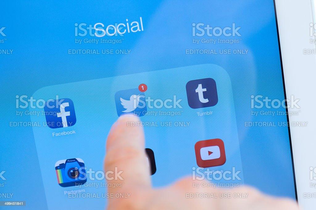 Ipad Air Finger Touching Twitter App Closeup Stock Photo