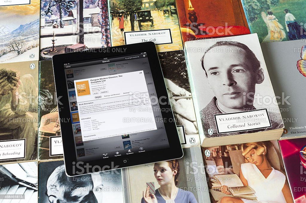 iPad and collection of paperbacks stock photo