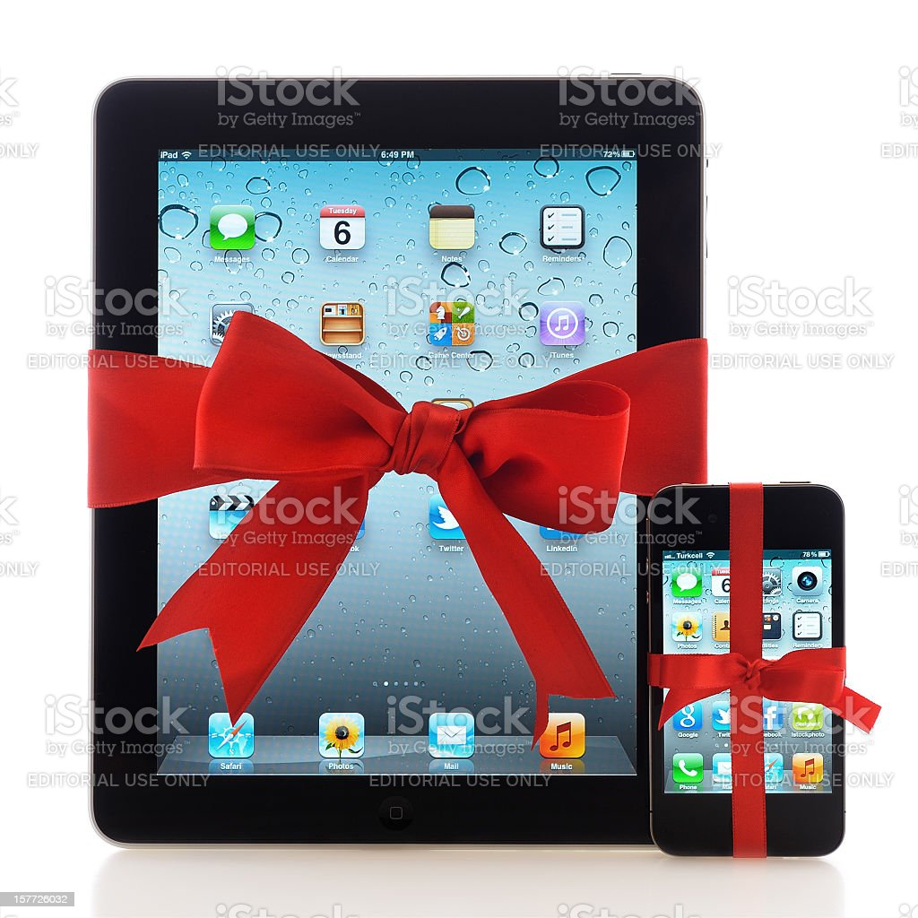 iPad and iPhone with red ribbon stock photo