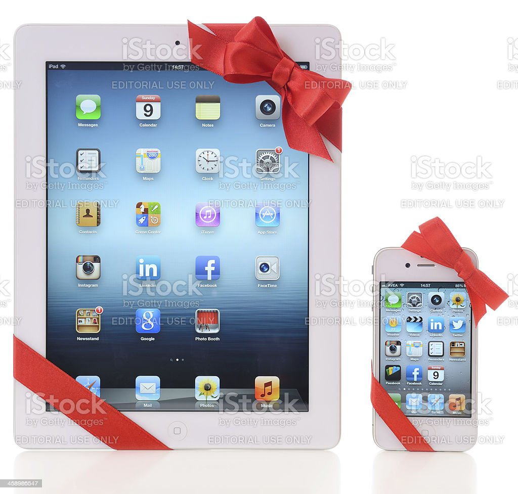 iPad and iPhone with red ribbon royalty-free stock photo