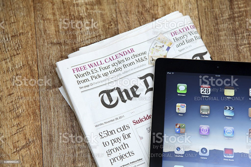 iPad and newspaper royalty-free stock photo