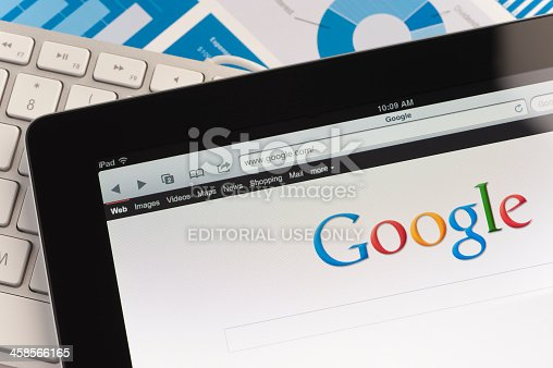 Sydney, Australia - September 6, 2011: Close up of an Apple Ipad and on a desk showing the Google search engine home screen. There is also a keyboard and some documents on the desk, the documents show charts and graphs. This scene depicts ipad in a working environment.