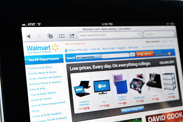 iPad Displaying Walmart Web Site Raleigh, NC - USA - June 27, 2011: Woman Holding an iPad Displaying Walmart Web Site. wal mart stock pictures, royalty-free photos & images