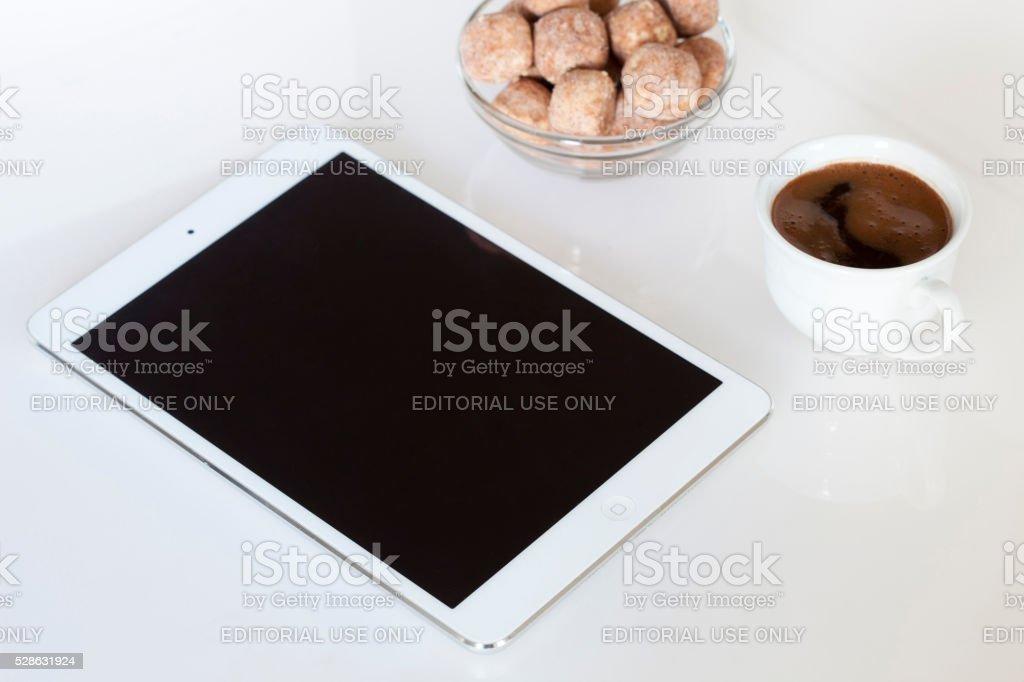 IPad mini and coffee stock photo