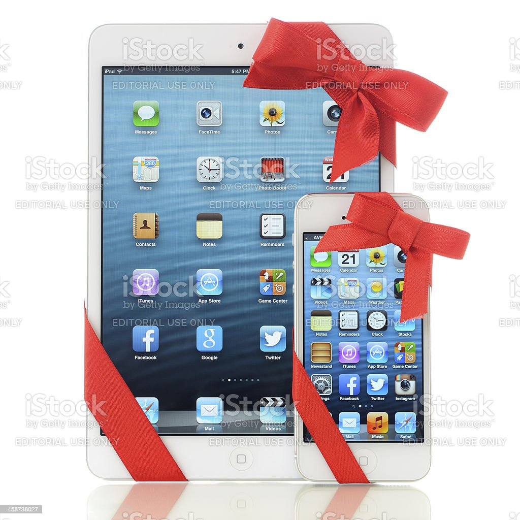 iPad Mini and iPhone 5 with red ribbon royalty-free stock photo