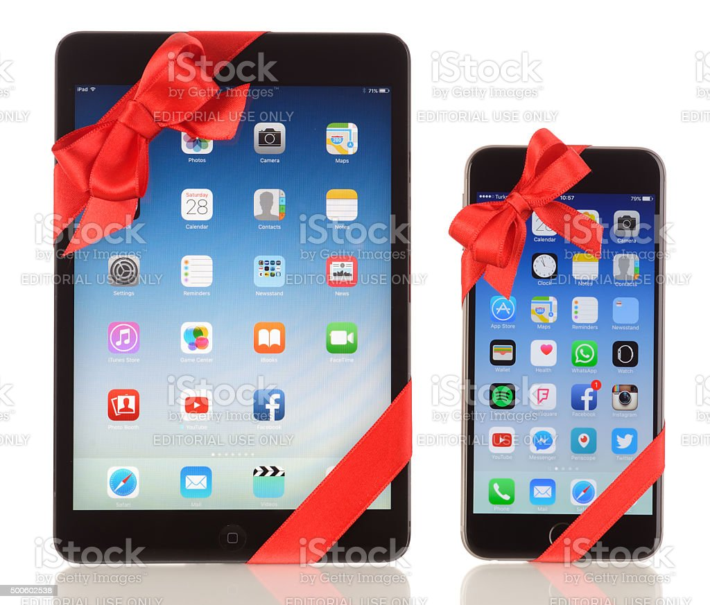 iPad Mini and iPhone 6 Plus with red ribbon stock photo