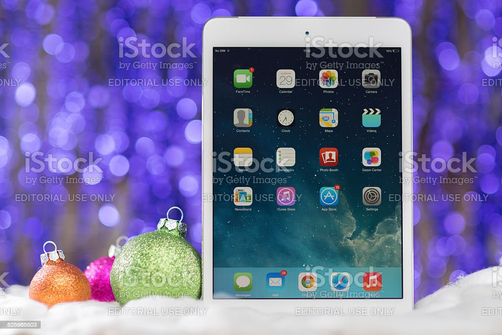 iPad mini at Christmas background stock photo