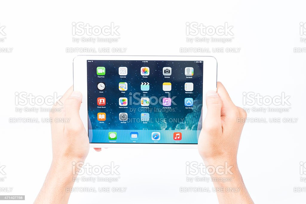 iPad Mini. holding it up with two hands stock photo