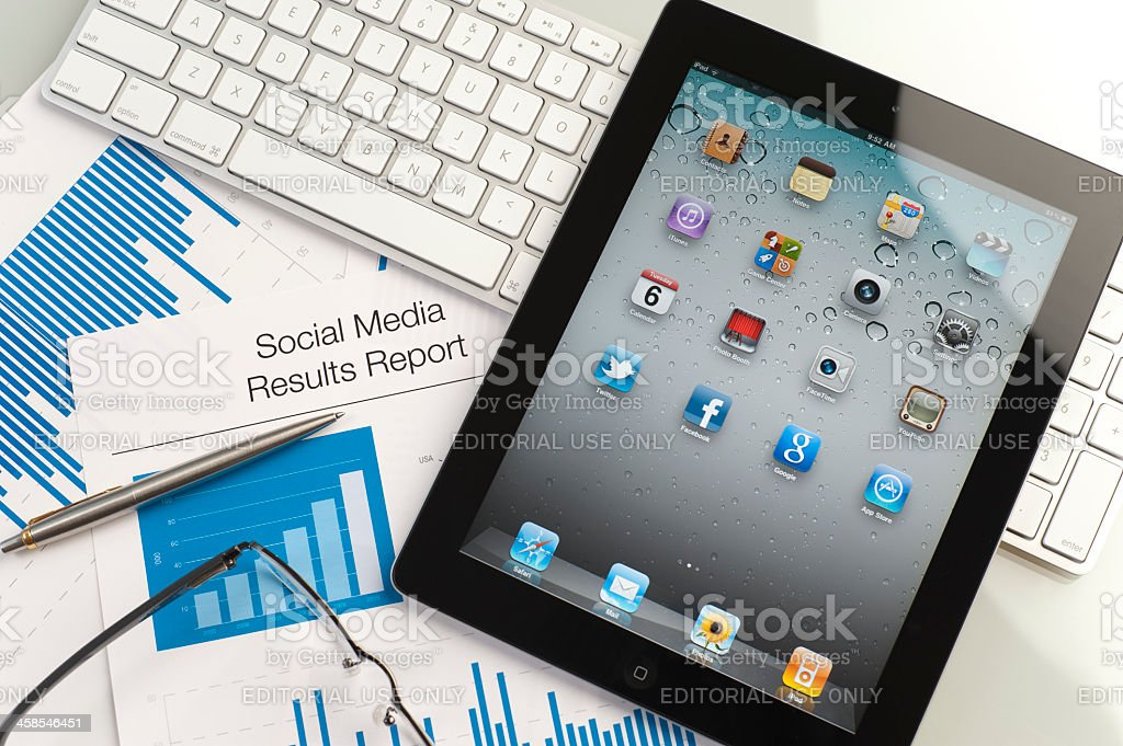 Ipad on a desk showing the home screen royalty-free stock photo
