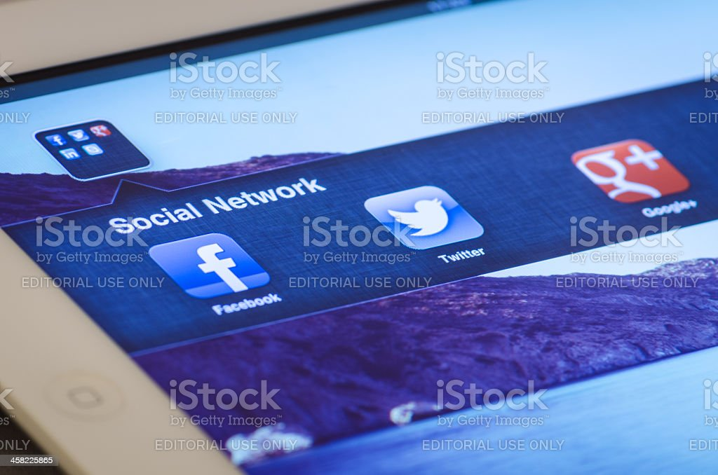 iPad screen shows three famous social network royalty-free stock photo