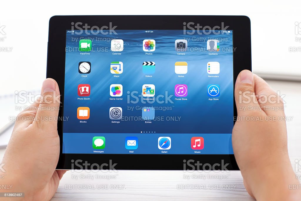iPad with IOS 8 on the screen in male hands