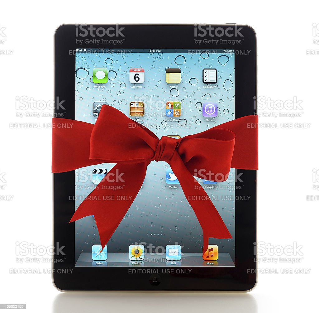 iPad with red ribbon stock photo