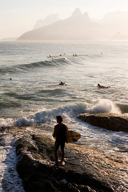 Ipanema Beach, Surfers and Landmark Mountains stock photo