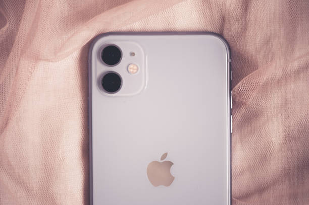 Iphone 11 in purple shade stock photo