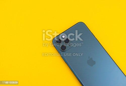Sankt-Petersburg, Russia - November 3, 2019: Iphone 11 Max Pro (midnight green) over yellow background studio shot