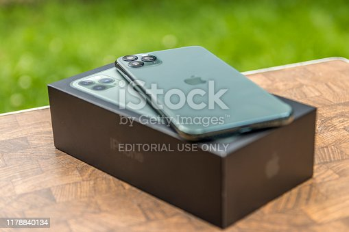 istock iPhone 11 Pro MAX Midnight Green laying on its box. 1178840134