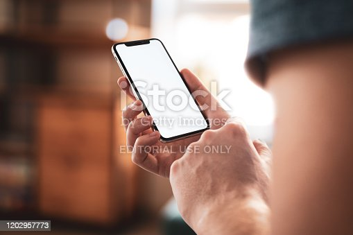 istock iPhone 11 Pro with blank screen template - modern frameless design 1202957773