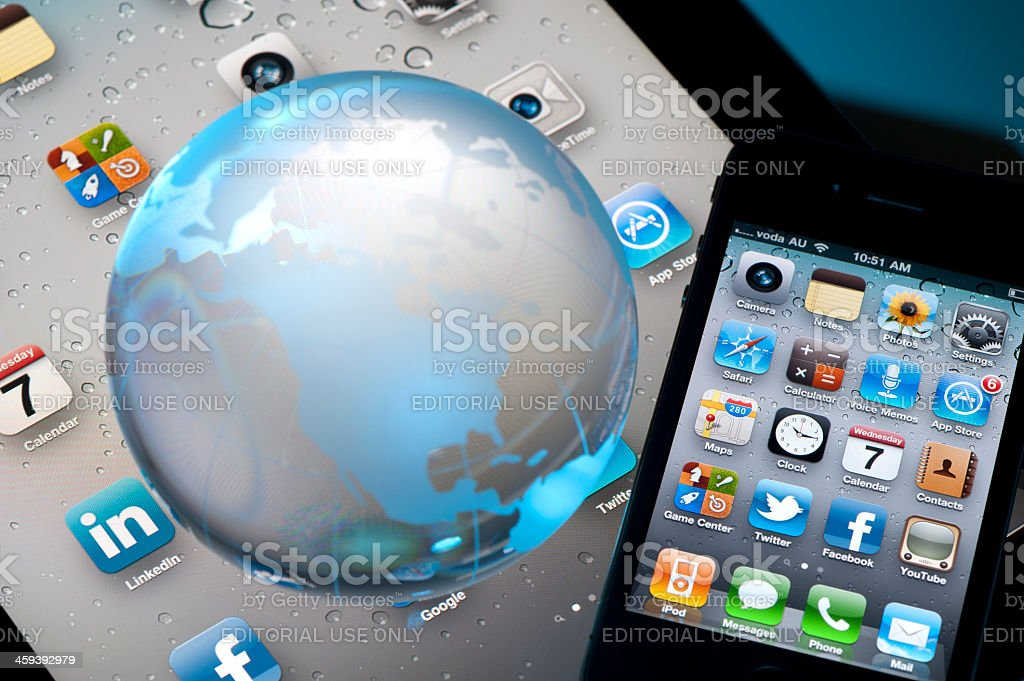 Iphone 4 and Ipad2 with a world globe royalty-free stock photo