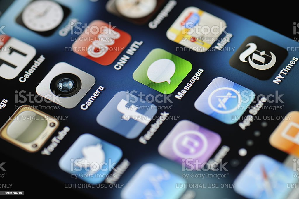 """iPhone 4 Apps """"MAnster, Germany - April 11, 2011: A close up of an illuminated Apple iPhone 4 screen showing the App Store and various apps, including YouTube, Camera, CNN, Facebook, Twitter, Messages, NYTimes and more."""" Apple Computers Stock Photo"""