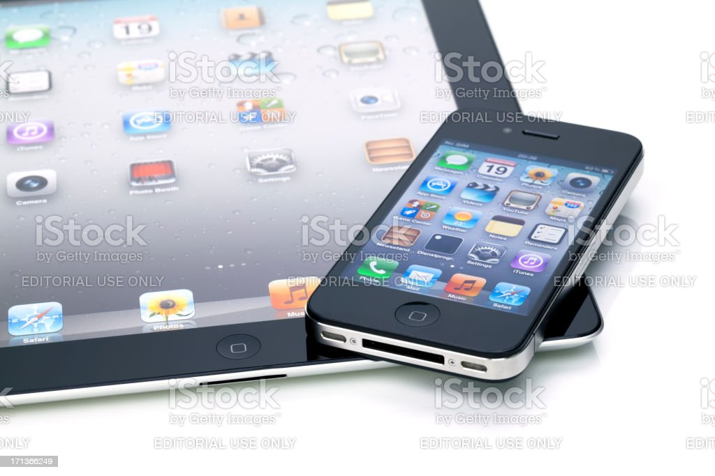 iPhone 4 on iPad 2 royalty-free stock photo