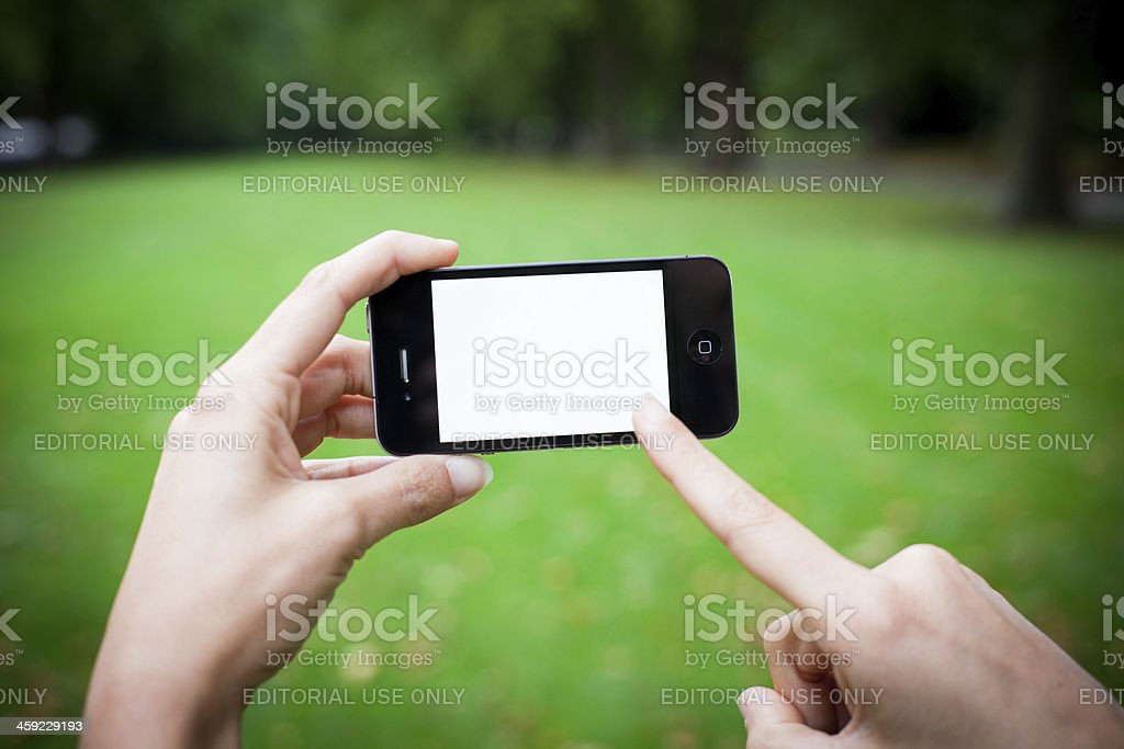 iPhone 4 with White Screen, Outdoors royalty-free stock photo