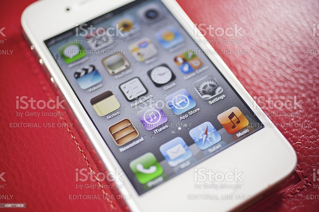 iphone 4s on red leather royalty-free stock photo