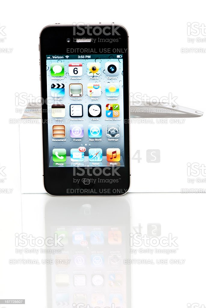 iPhone 4S On Reflective Surface With Original Box royalty-free stock photo